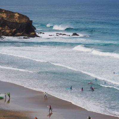 Surfers at Playa de Viejo Rey, La Pared, Fuerteventura